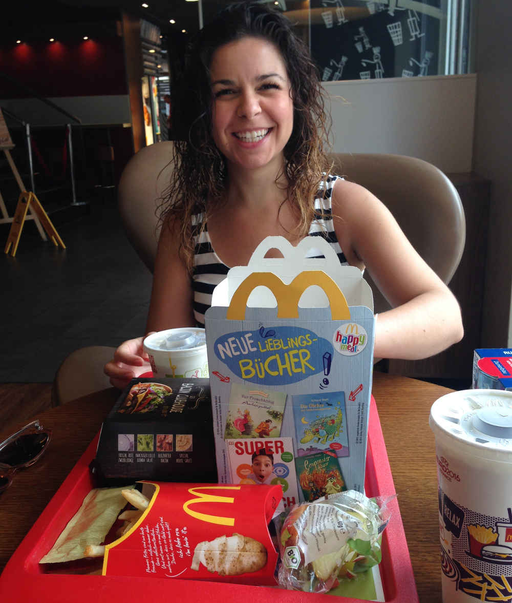 Amber Merrick eating a happy meal at German McDonalds